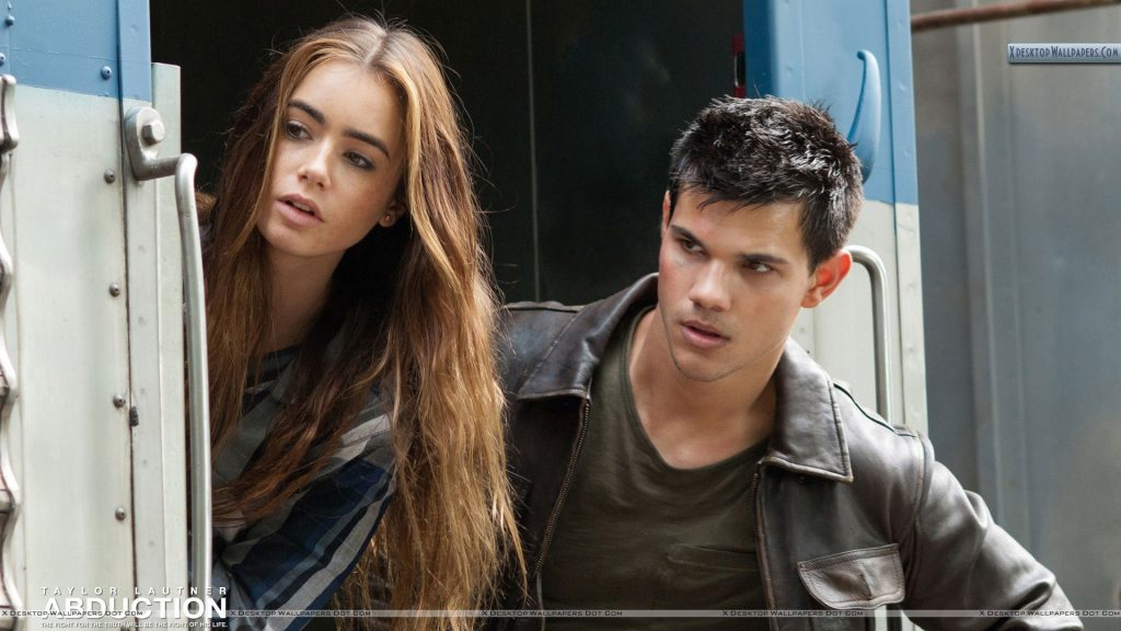 Abduction-Taylor-Lautner-Lily-Collins-Looking-Somthing-PIC-MCH038293-1024x576 Taylor Lautner Desktop Wallpaper 45+