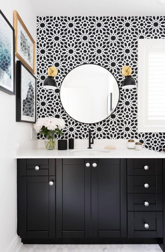 chic-small-bathroom-with-black-white-wallpaper-also-round-mirror-and-sconces-PIC-MCH052386-670x1024 Wallpaper Trends For Bathrooms 14+