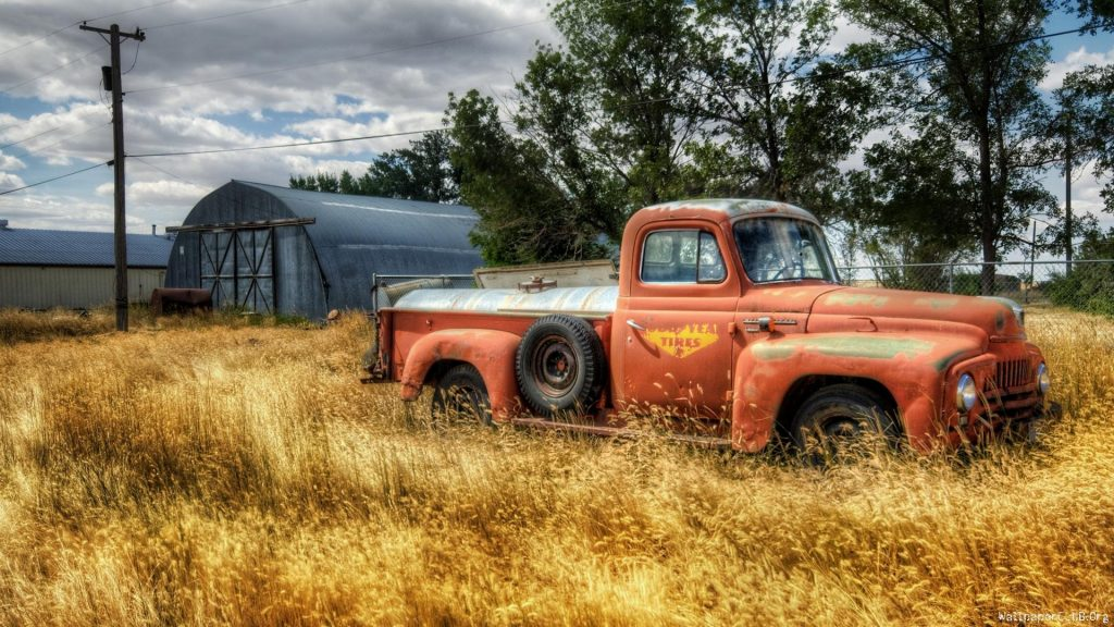 vintage-trucks-Old-Rusty-Orange-Vintage-Pickup-Truck-Against-Blue-Background-by-wallpaper-wp-PIC-MCH0110366-1024x576 Free Old Truck Wallpaper 52+